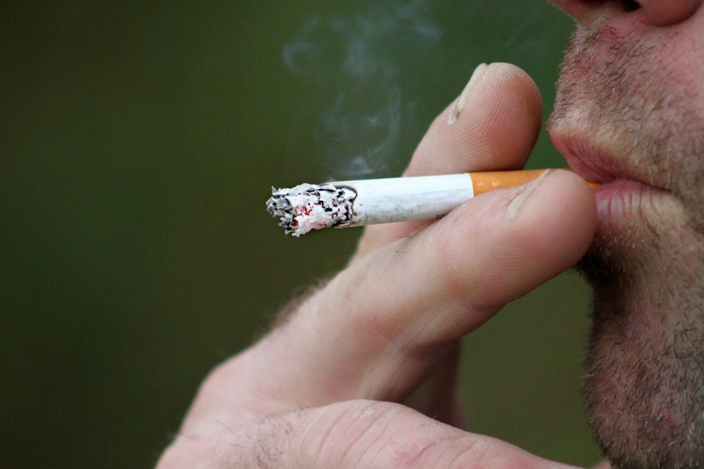 close-up of person smoking cigarette
