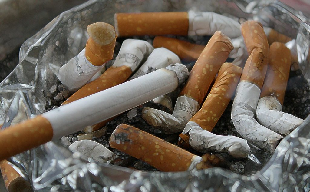 Dirty ashtray full of cigarettes